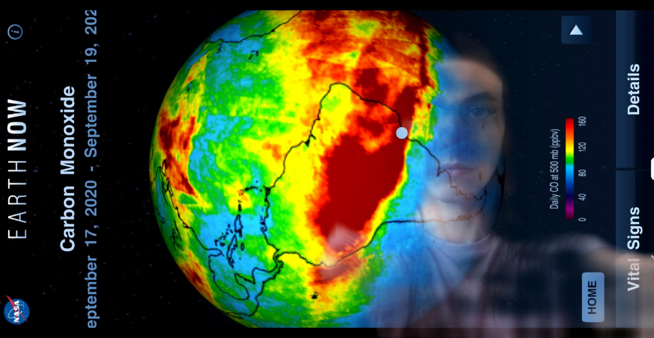 the image of a phone screen with a thermal map of the world superimposed over a person's face