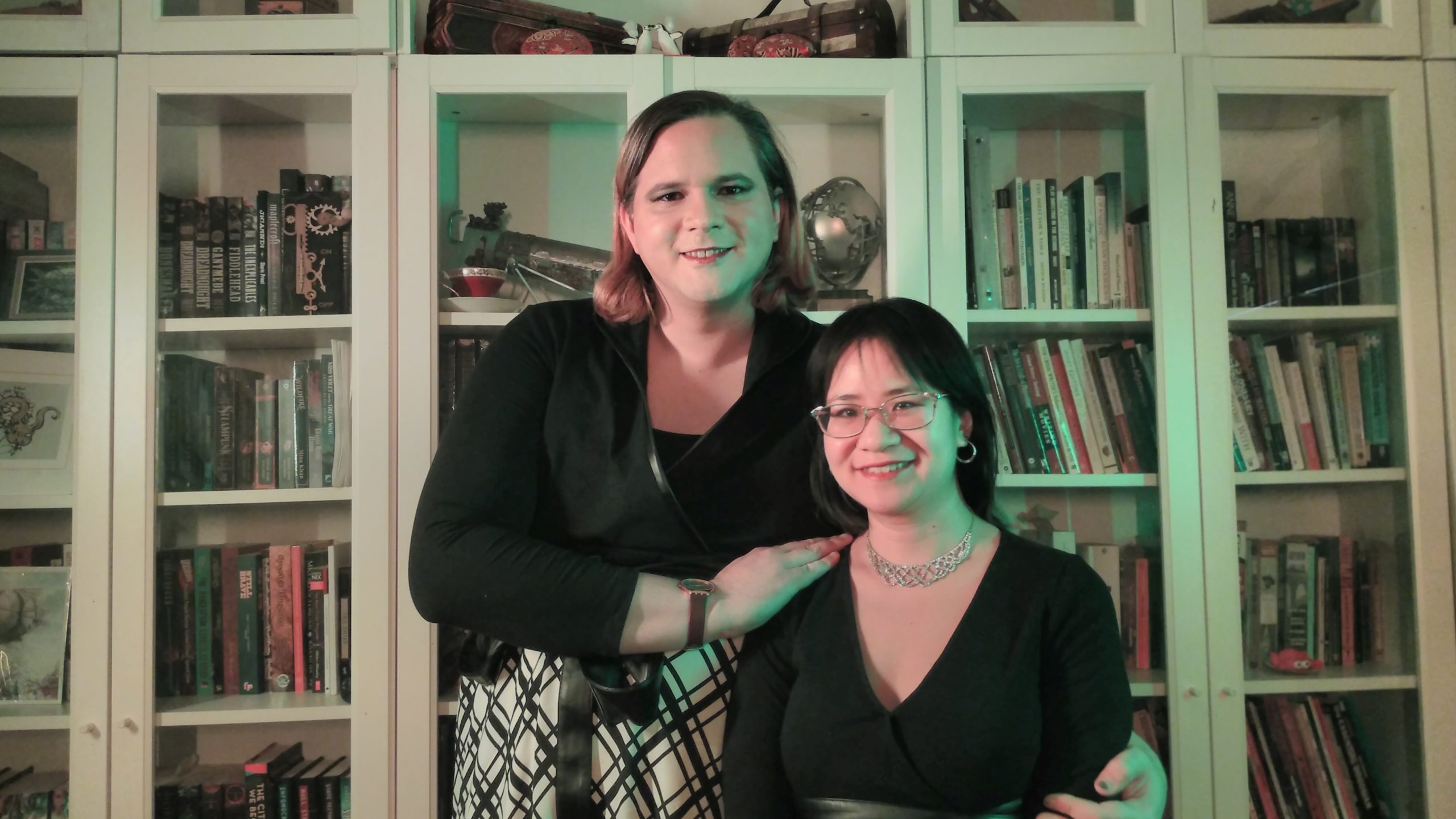 Diana M. Pho and Ashley Rogers in front of a bookcase smiling at the camera